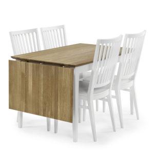 Ett fint matbord med fina stolar som finns i vitt och oljad ek.