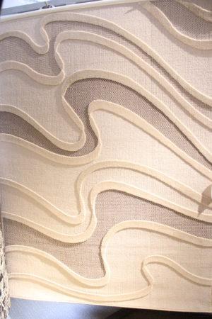 Mattan pluto från strehög. Mattan är beige i storlek 140x200 cm.