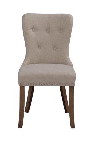 Fin stol med knappar i ryggen. Stolen passar bra till matbord. Denna stol heter Adele och finns i flera olika färger. Välj mellan beige, grå och svart. Ben finns i vintage, vit och brun.