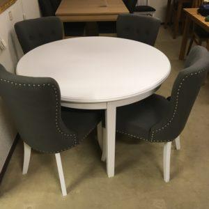 Runt vitt matbord från Rowico. Koster som bordet heter finns även som ovalt och vanligt matbord.